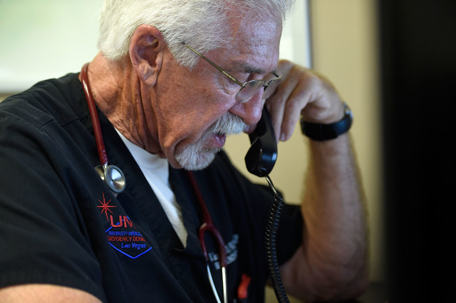 University Medical Center Chief of Staff Dr. Dale Carrison dictates notes after tending to a patient in the emergency department at the hospital Monday, Oct. 24, 2016, in Las Vegas. Carrison, a 26 ...