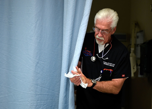 University Medical Center Chief of Staff Dr. Dale Carrison moves between patients at the hospital Monday, Oct. 24, 2016, in Las Vegas. Carrison, a 26-year veteran at the hospital will be honored a ...