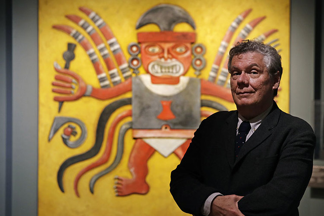 Jeffrey Quilter, director at the Peabody Museum of Archaeology & Ethnology, poses in front of reproduction of a Peruvian Decapitator God, at Harvard University. The Peabody, one of the oldest  ...
