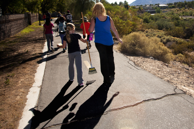 Volunteers walk to the Pittman Wash area in Henderson during National Public Lands Day Sept. 24 to assist in a wash cleanup sponsored by Project GREEN: Friends of Pittman Wash. Jeferson Applegate/View