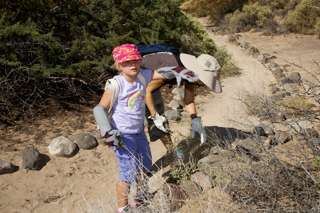Eleanor Stender, 7, who wishes to become a Master Gardener, and her mother, Melinda Stender, clear walking paths at the Pittman Wash area in Henderson Sept. 24. Eleanor is enrolled in the Junior M ...