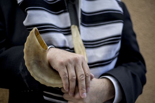 Rabbi Mendy Harlig of Chabad of Green Valley, whose synagogue is offering free seating to services during High Holy Days, holds a rams horn, Thursday, Sept. 29, 2016, in Henderson. Elizabeth Page  ...
