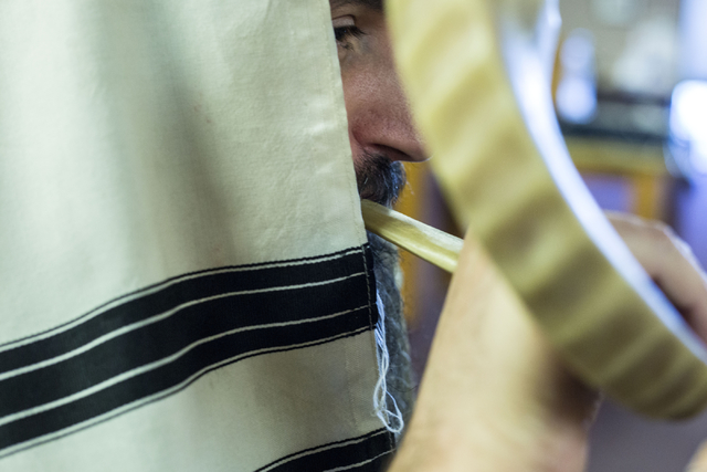 Rabbi Mendy Harlig of Chabad of Green Valley, whose synagogue is offering free seating to services during High Holy Days, blows on a rams horn, Thursday, Sept. 29, 2016, in Henderson. Elizabeth Pa ...