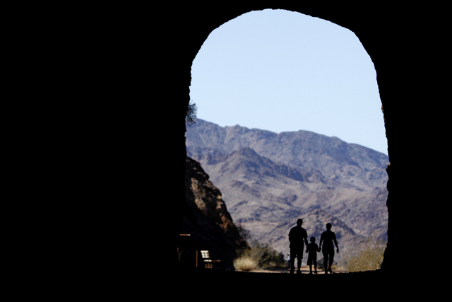 A family walks through a tunnel on the Historic Railroad Trail at Lake Mead National Recreation Area on Feb. 23, 2014. Starting Tuesday, the trail, along with a 17-mile stretch of the River Mounta ...