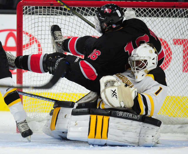 UNLV forward Dion Antisin falls onto Arizona State goalie Ryan Seltenreich during their ACHA Division II club hockey game at T-Mobile Arena  in Las Vegas Sunday, Oct. 9, 2016. (Josh Holmberg/Las V ...