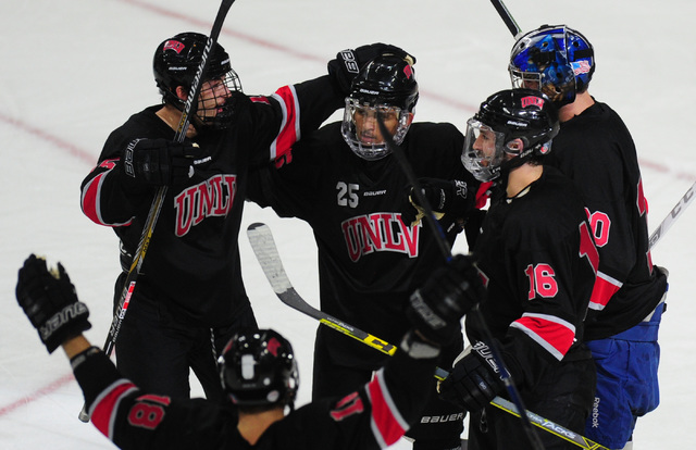 UNLV players celebrate their 3-2 victory over Arizona State during their ACHA Division II club hockey game at T-Mobile Arena  in Las Vegas Sunday, Oct. 9, 2016. (Josh Holmberg/Las Vegas Review-Jou ...