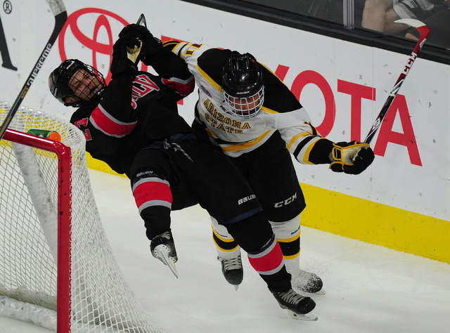 Arizona State forward Garrett Anderson, right, checks UNLV forward Steven Terry during their ACHA Division II club hockey game at T-Mobile Arena  in Las Vegas Sunday, Oct. 9, 2016. Velasco was pen ...