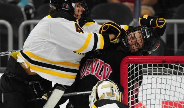 Arizona State forward  Michael Malinowski  roughs up UNLV forward Ethan Montoya during their ACHA Division II club hockey game at T-Mobile Arena  in Las Vegas Sunday, Oct. 9, 2016. UNLV won 3-2. ( ...