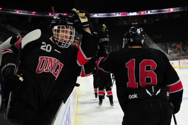 UNLV's Cody Lane (20) high fives Dion Antisin after  a goal against Arizona State during their ACHA Division II club hockey game at T-Mobile Arena  in Las Vegas Sunday, Oct. 9, 2016. UNLV won 3-2. ...