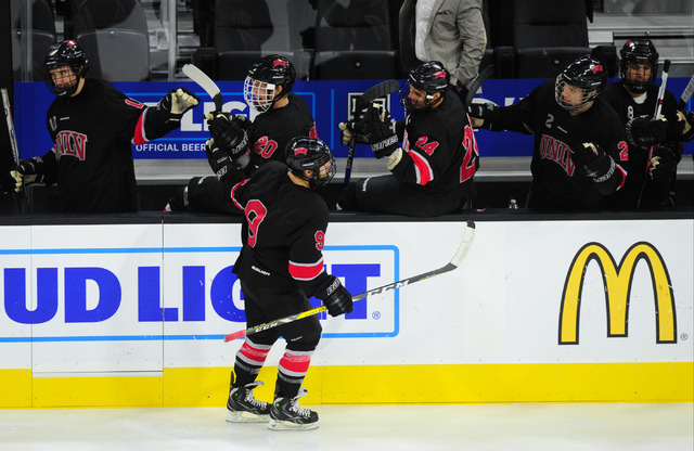 UNLV's Cody Williams (9) high fives players on the bench after a goal against Arizona State during their ACHA Division II club hockey game at T-Mobile Arena  in Las Vegas Sunday, Oct. 9, 2016. UNL ...