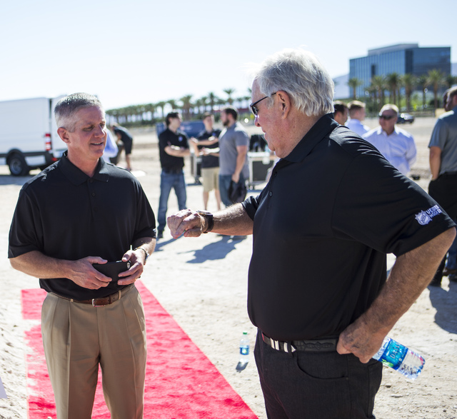 Bill Foley, owner of Las Vegas' NHL expansion team, right, talks with the team's president, Kerry Bubolz, after the groundbreaking ceremony for the team's practice facility and headquarters in Las ...