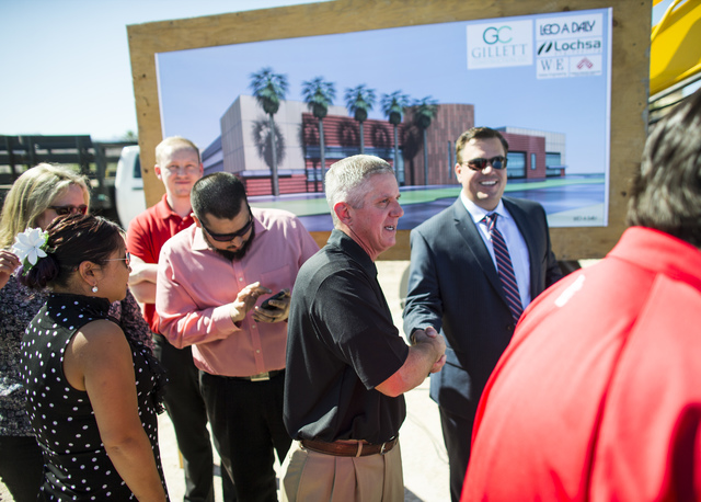 Kerry Bubolz, president of Las Vegas' NHL expansion team, center left, mingles with the crowd after the groundbreaking ceremony for the team's practice facility and headquarters in Las Vegas on We ...