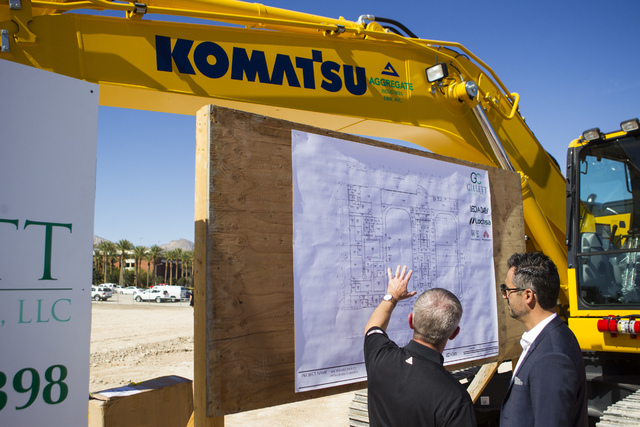 Kerry Bubolz, president of Las Vegas' NHL expansion team, left, looks at the blueprints after the groundbreaking ceremony for the team's practice facility and headquarters in Las Vegas on Wednesda ...