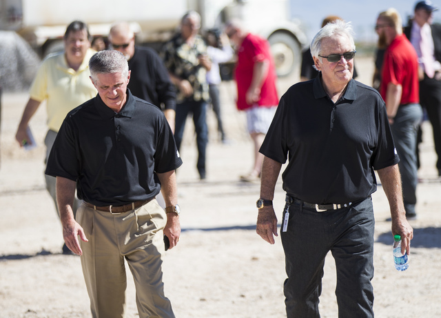 Bill Foley, owner of Las Vegas' NHL expansion team, right, walks with the team's president, Kerry Bubolz, after the groundbreaking ceremony for the team's practice facility and headquarters in Las ...