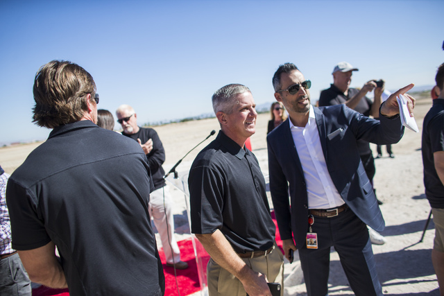 Kerry Bubolz, president of Las Vegas' NHL expansion team, left, looks at renderings following the groundbreaking ceremony for the team's practice facility and headquarters in Las Vegas on Wednesda ...