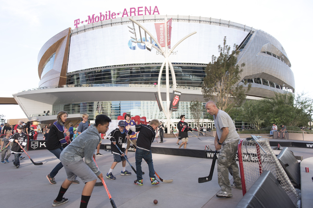 Children play a game of street hockey during the Vegas Hockey Fan Fest at Toshiba Plaza in Las Vegas, Saturday, Oct. 8, 2016. Jason Ogulnik/Las Vegas Review-Journal