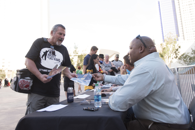 Henry Bojda, left, gets an autograph from retired NHL player Darren Banks during the Vegas Hockey Fan Fest at Toshiba Plaza in Las Vegas, Saturday, Oct. 8, 2016. Jason Ogulnik/Las Vegas Review-Journal