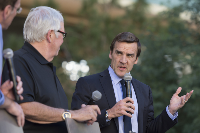 Las Vegas NHL franchise General Manager George McPhee, right, and owner Bill Foley talk on stage during Vegas Hockey Fan Fest at Toshiba Plaza in Las Vegas, Saturday, Oct. 8, 2016. Jason Ogulnik/L ...