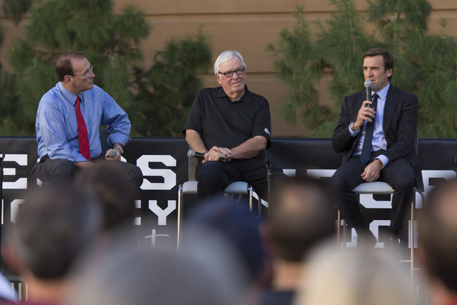Las Vegas NHL franchise owner Bill Foley, center, and general manager George McPhee, right, do a Q & A session during the Vegas Hockey Fan Fest at Toshiba Plaza in Las Vegas, Saturday, Oct. 8, ...