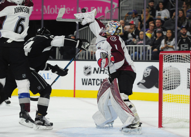 Colorado Avalanche goalie Semyon Varlamov makes a blocker save against the Los Angeles Kings in the first period of their NHL preseason hockey game at T-Mobile Arena in Las Vegas Saturday, Oct. 8, ...