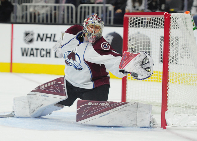 Colorado Avalanche goalie Semyon Varlamov makes a glove save against the Los Angeles Kings in the first period of their NHL preseason hockey game at T-Mobile Arena in Las Vegas Saturday, Oct. 8, 2 ...