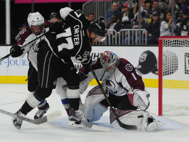 Colorado Avalanche goalie Semyon Varlamov makes a pad save in off of Los Angeles Kings forward Jeff Carter (77) as defenseman Erik Johnson (6) defends  in the first period of their NHL preseason h ...