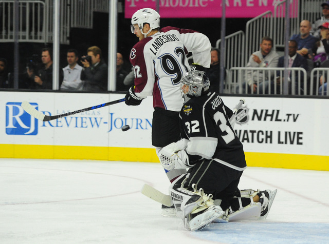Los Angeles Kings goalie Jonathan Quick (32) makes a save as Colorado Avalanche left wing Gabriel Landeskog (92) looks for a rebound in the second period of their NHL preseason hockey game at T-Mo ...
