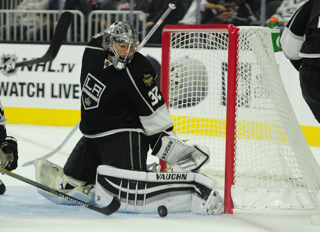 Los Angeles Kings goalie Jonathan Quick (32) makes a save against the Colorado Avalanche in the second period of their NHL preseason hockey game at T-Mobile Arena in Las Vegas Saturday, Oct. 8, 20 ...