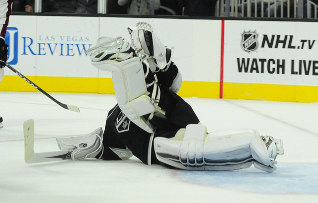 Los Angeles Kings goalie Jonathan Quick (32) looks to make a pad save against the Colorado Avalanche in the second period of their NHL preseason hockey game at T-Mobile Arena in Las Vegas Saturday ...