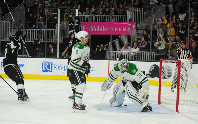 Los Angeles Kings forward Michael Mersch, center, and center Nic Dowd (67) celebrate a goal in front of Dallas Stars goalie Antti Niemi (31) in the first period of their NHL preseason hockey game  ...