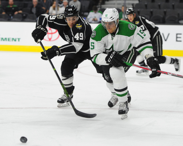 Los Angeles Kings forward Michael Mersch, left and Dallas Stars defenseman Patrik Nemeth (15) battle for a loose puck in the first period of their NHL preseason hockey game  at T-Mobile Arena  in  ...
