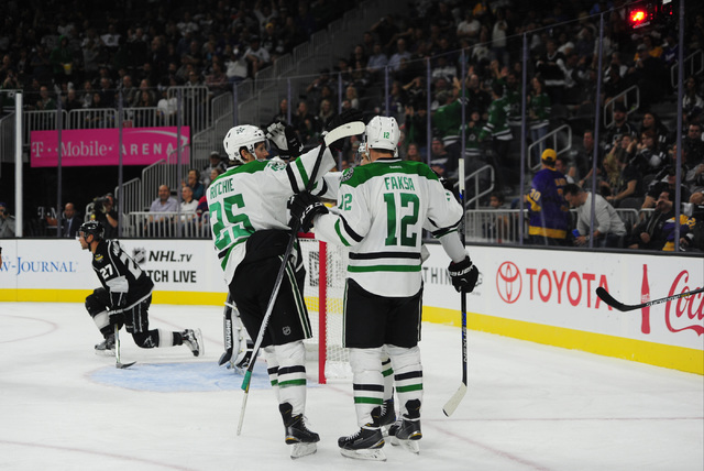 Dallas Stars players celebrate a goal against the L.A. Kings in the second period of their NHL preseason hockey game at T-Mobile Arena  in Las Vegas, Friday, Oct. 07, 2016. (Josh Holmberg/Las Vega ...
