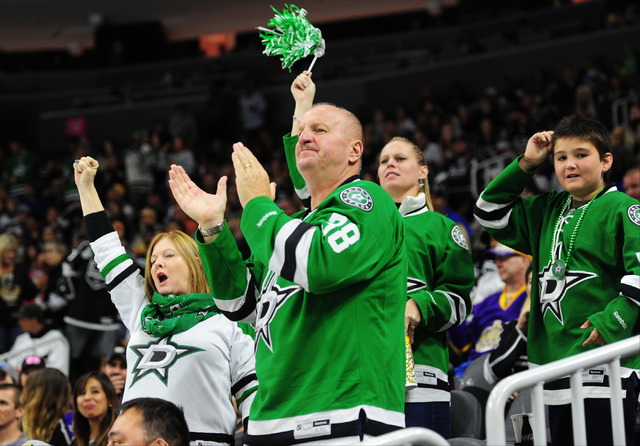 Dallas Stars fans celebrate a goal against the Los Angeles Kings in the third period of their NHL preseason hockey game at T-Mobile Arena in Las Vegas Friday, Oct. 07, 2016. Dallas won 6-3. (Josh  ...