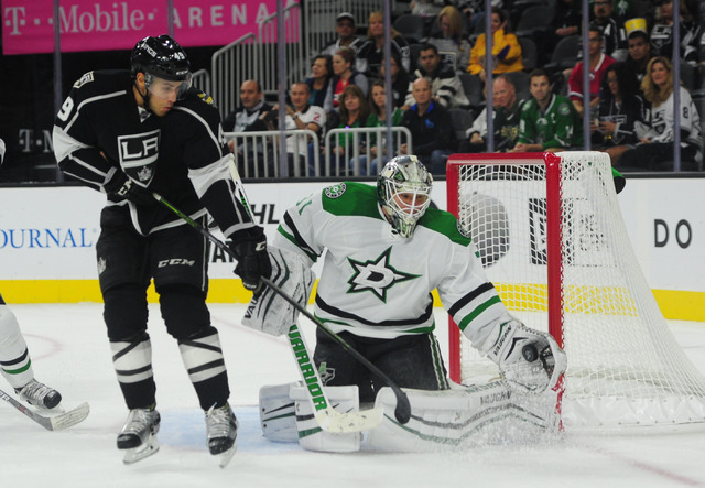 Dallas Stars goalie Antti Niemi (31) makes a glove save as Los Angeles Kings forward Michael Mersch, left, awaits a possible rebound in the third period of their NHL preseason hockey game at T-Mob ...