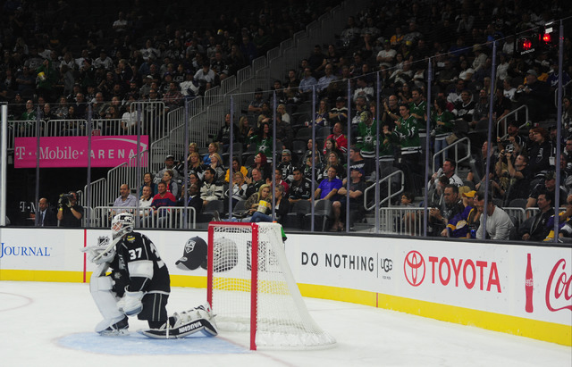 Los Angeles Kings goalie Jeff Zatkoff reacts after giving up a goal against the Dallas Stars in the second period of their NHL preseason hockey game at T-Mobile Arena  in Las Vegas, Friday, Oct. 0 ...
