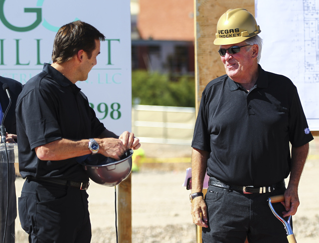 Bill Foley, owner of Las Vegas' NHL expansion team,  right, talks with George McPhee, general manager of the team, during the groundbreaking ceremony for the team's practice facility and headquart ...