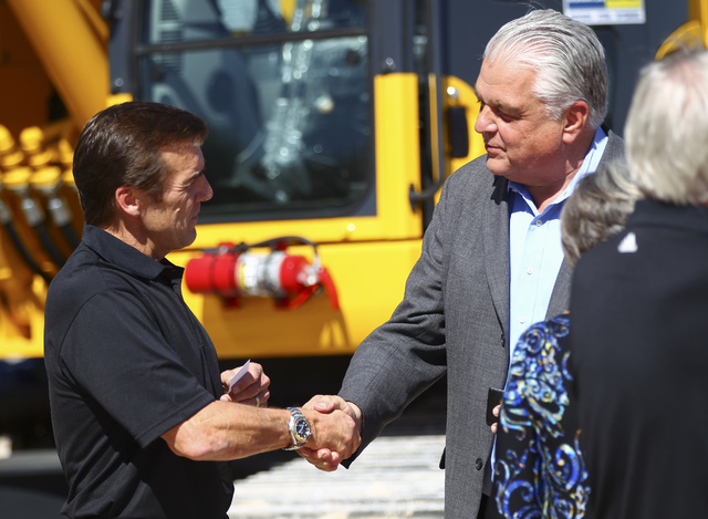 George McPhee, general manager of Las Vegas' NHL expansion team, left, greets Clark County Commissioner Steve Sisolak after the groundbreaking ceremony for the team's practice facility and headqua ...