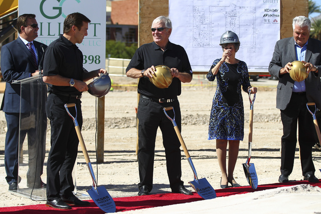 Bill Foley, owner of Las Vegas' NHL expansion team,  center, talks with George McPhee, general manager of the team, during the groundbreaking ceremony for the team's practice facility and headquar ...