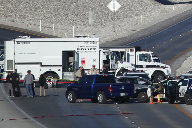 Police work the scene of a fatal officer-involved shooting on the 215 Beltway near North Hualapai Way in northwest Las Vegas on Thursday, Oct. 13, 2016. (Brett Le Blanc/Las Vegas Review-Journal Fo ...