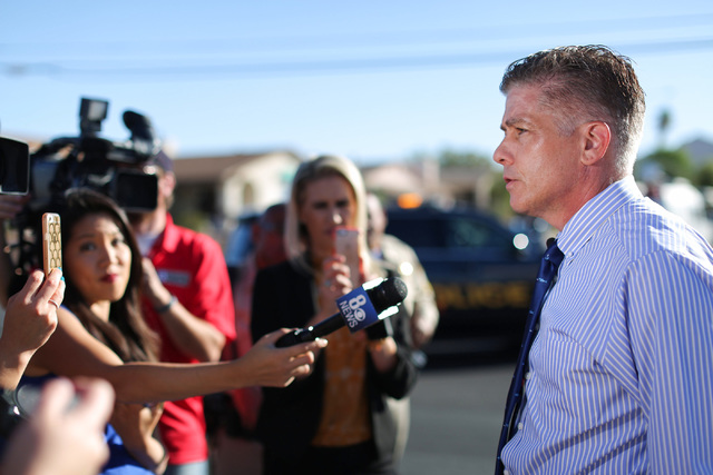 Las Vegas police homicide Lt. Dan McGrath briefs media members about a shooting that left one person dead at a gas station at the intersection of Lake Mead and Hollywood boulevards in Las Vegas on ...