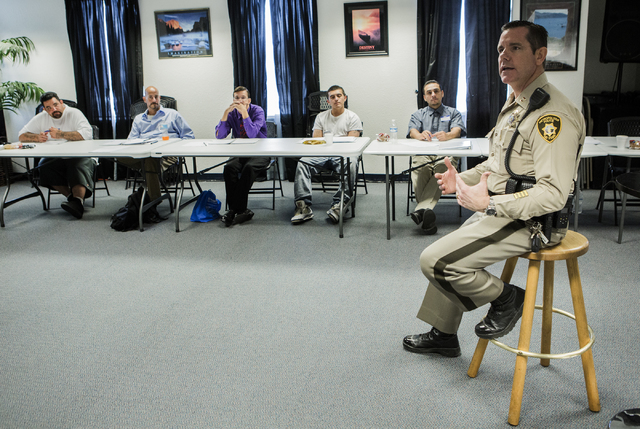 Las Vegas police correctional officer Capt. Bill Teel addresses former inmates during a pre-vocational leadership workshop at Hope for Prisoners, 3430 E. Flamingo Road, on Thursday Aug. 18, 2016.  ...