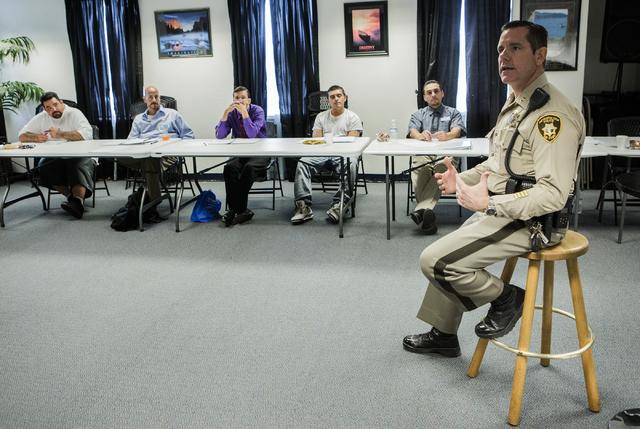 Las Vegas police correctional officer Capt. Bill Teel addresses former inmates during a pre-vocational leadership workshop at Hope for Prisoners, 3430 E. Flamingo Road, on Thursday Aug. 18, 2016.  ...