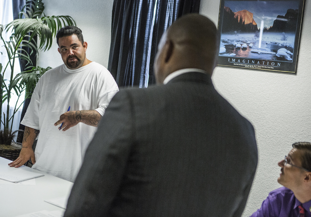 Adrian Romero, left, asks the Rev. Jon Ponder, founder of Hope for Prisoners, a question on Thursday, Aug. 18, 2016. (Jeff Scheid/Las Vegas Review-Journal) Follow @jeffscheid