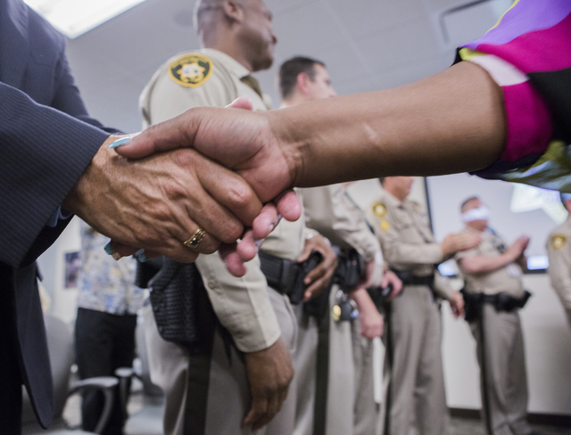 Jannie James shakes hands after a Hope for Prisoners graduation at Metropolitan Police Department headquarters, 400 S. Martin Luther King Blvd., on Friday, Aug. 19, 2016. (Jeff Scheid/Las Vegas Re ...