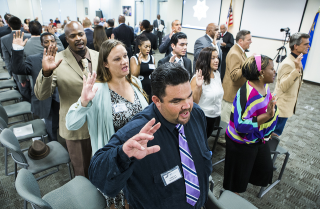 Hope for Prisoners clients take an oath during a graduation at Metropolitan Police Department headquarters, 400 S. Martin Luther King Blvd., on Friday, Aug. 19, 2016. (Jeff Scheid/Las Vegas Review ...