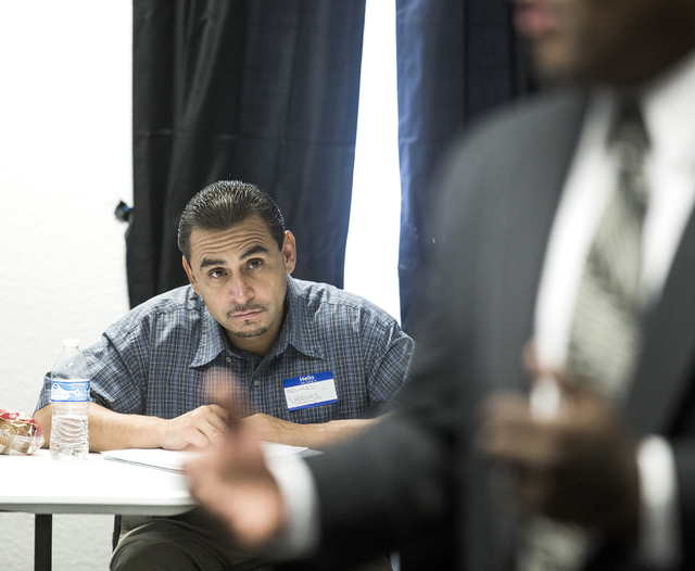 Former prisoner Edward Vargas, left, listens while the Rev. Jon Ponder, founder of Hope for Prisoners, speaks during a pre-vocational leadership workshop on Thursday, Aug. 18, 2016. (Jeff Scheid/L ...