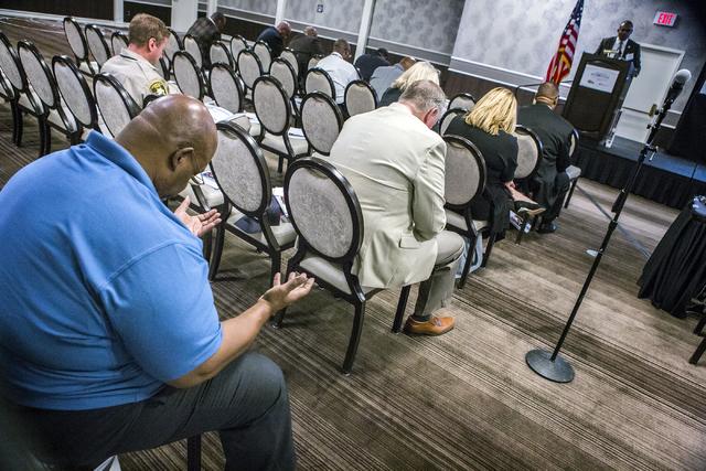 A man raises his hands during an opening prayer at the Repairing the Breach summit Thursday, Oct. 13, 2016, at Palace Station in Las Vegas. (Jeff Scheid/Las Vegas Review-Journal) Follow @jeffscheid