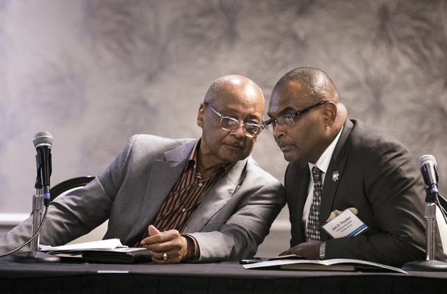 Bob Woodson, left, founder of the Center for Neighborhood Enterprise in Washington, D.C., and the Rev. Jon Ponder, founder and CEO of Hope for Prisoners, talk during the Repairing the Breach summi ...