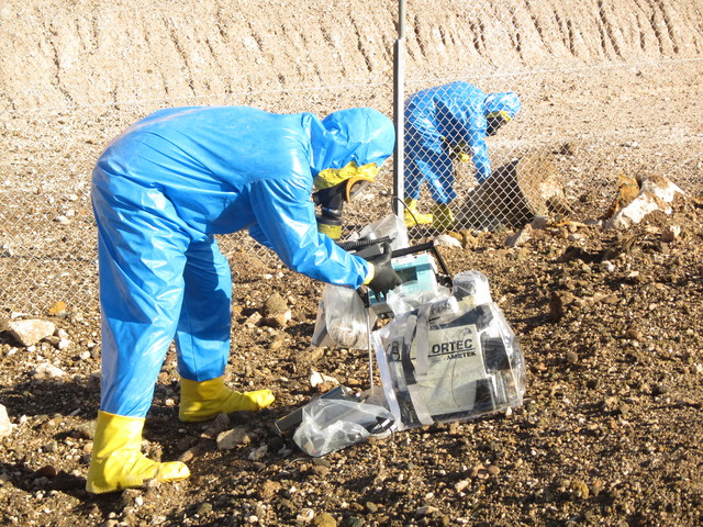 An entry team surveys the eruption site at the state's low-level radioactive waste landfill 11 miles south of Beatty on Oct. 19, 2015. (Maj. Nate Taylor/Nevada Army National Guard)