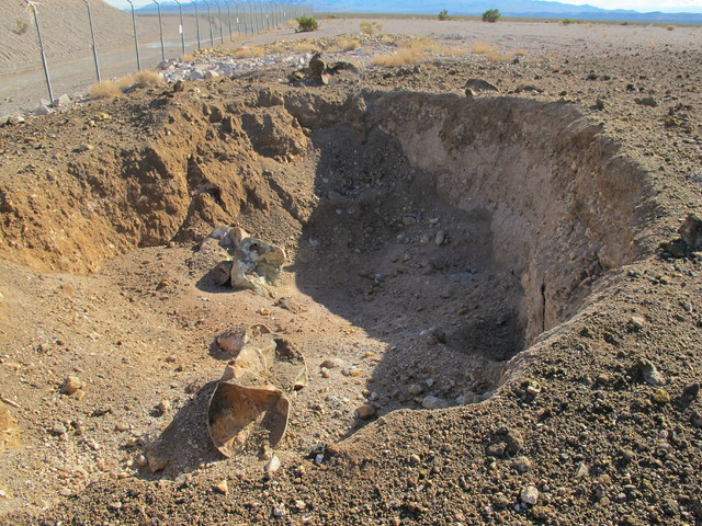 A 20-foot-diameter subsidence crater was left after Nevada's low-level radioactive waste landfill erupted Oct. 18, 2015. (Maj. Nate Taylor/Nevada Army National Guard)